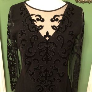 Black top with Velvet Scrollwork on a sheer panel.